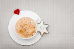White cup coffee christmas gingerbread cake star heart symbol love Royalty Free Stock Image