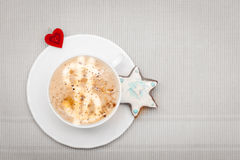 White cup coffee christmas gingerbread cake star heart symbol love Stock Image