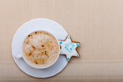 White cup coffee and christmas gingerbread cake star Stock Images