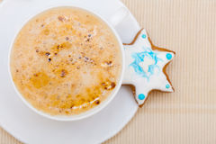 White cup coffee and christmas gingerbread cake star Stock Photo
