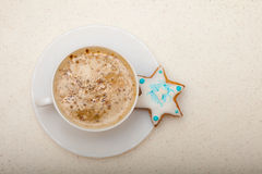 White cup coffee and christmas gingerbread cake star Stock Image