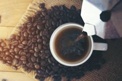 White cup of coffee with coffee bean royalty free stock photos