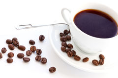 White cup of coffee and coffee beans Stock Photo
