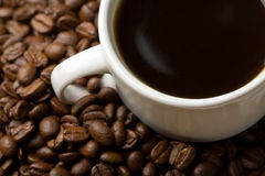 White cup of coffee and coffee beans Royalty Free Stock Images