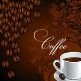 White Cup with coffee, coffee beans and designs on a dark background. Royalty Free Stock Photo