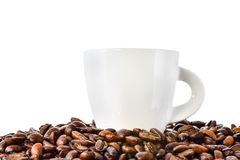 White cup of coffee and coffee beans on white background Stock Photography