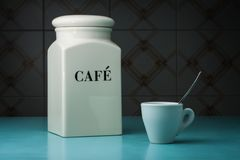 White cup of coffee with coffee container Stock Photography