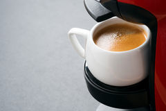 White cup of coffee in the coffee machine and space for text Stock Photography