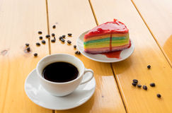 White cup coffee with color crape cake on wood table focus on cr Stock Photography
