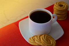 White cup of coffee with cookies. Round cookies. biscuits for te. Round tea cookies. biscuits for tea or coffee Stock Image
