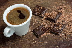 White cup of coffee and dark chocolate. Background Royalty Free Stock Photos