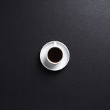 A white cup of coffee on a dark grey desk background Stock Photo