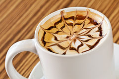 White cup of coffee with decoration on top Royalty Free Stock Photos