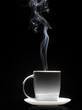 White cup of coffee with a dense smoke Stock Images