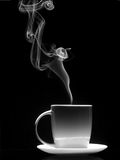 White cup of coffee with a dense smoke Stock Photos