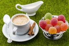 White cup of coffee with dessert on a green grass Stock Photo