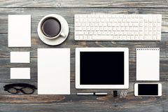 White cup of coffee with digital tablet on table Stock Image
