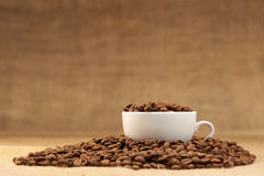 White cup with coffee grains Royalty Free Stock Images