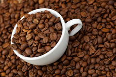 White cup with coffee grains Royalty Free Stock Photos