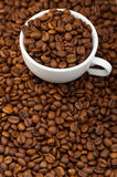 White cup with coffee grains Royalty Free Stock Photography