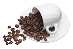 White cup with coffee grains Stock Photos