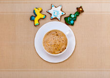 White cup coffee handmade gingerbread cakes with icing. Christmas. Royalty Free Stock Photos