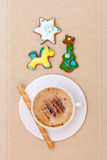 White cup coffee handmade gingerbread cakes waffle roll. Christmas. Stock Photos