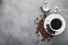 White cup of coffee with headphone and coffee beans Stock Images