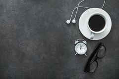 White cup of coffee with headphone. On a stone table. break music concept. top view with copyspace Stock Photography