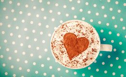 White cup of coffee with heart shape symbol royalty free stock photos