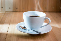 White cup of coffee,  hot espresso on wooden table Royalty Free Stock Photography