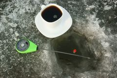White cup of coffee on ice Stock Images