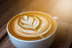 A white cup of coffee latte or cappuccino art Royalty Free Stock Image