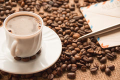 White cup of coffee; a letter and  pen on the background of cof Stock Photography