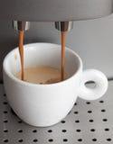 White cup in coffee machine. Espresso preparing Royalty Free Stock Photo