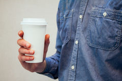 White cup of coffee in man`s hand Stock Photos