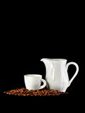 White cup of coffee, mug and coffee beans on black background Stock Photos