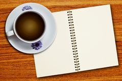 White cup of coffee and notebook Royalty Free Stock Photography
