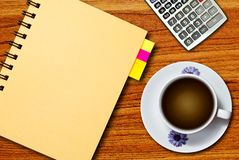 White cup of coffee and notebook Stock Photo