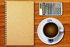 White cup of coffee and notebook Royalty Free Stock Images