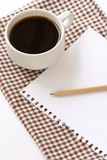 White cup coffee with notepad and pencil Stock Photo