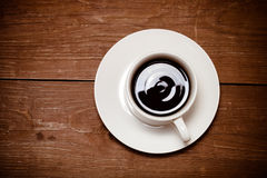 White cup of coffee on old wooden table. Toned Royalty Free Stock Images