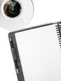 White Cup of coffee and One face white blank page. Sketch book with black pencil on white background Royalty Free Stock Photography