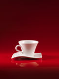 White cup of coffee on red background Stock Photography