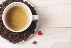 White cup of coffee with red hearts decoration Stock Image