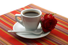 White cup of coffee with a red rose Stock Image