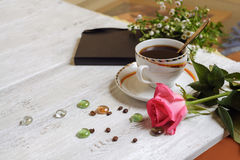 White cup of coffee with rose and wildflowers Royalty Free Stock Photography