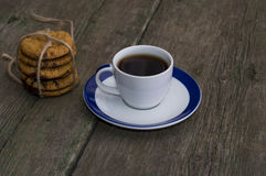 White cup of coffee on a saucer with a blue border Royalty Free Stock Images