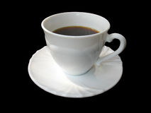 White cup of coffee on saucer isolated on black Stock Images