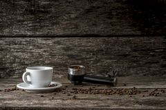 White cup of coffee, scattered coffee beans and ground coffee in Stock Photos
